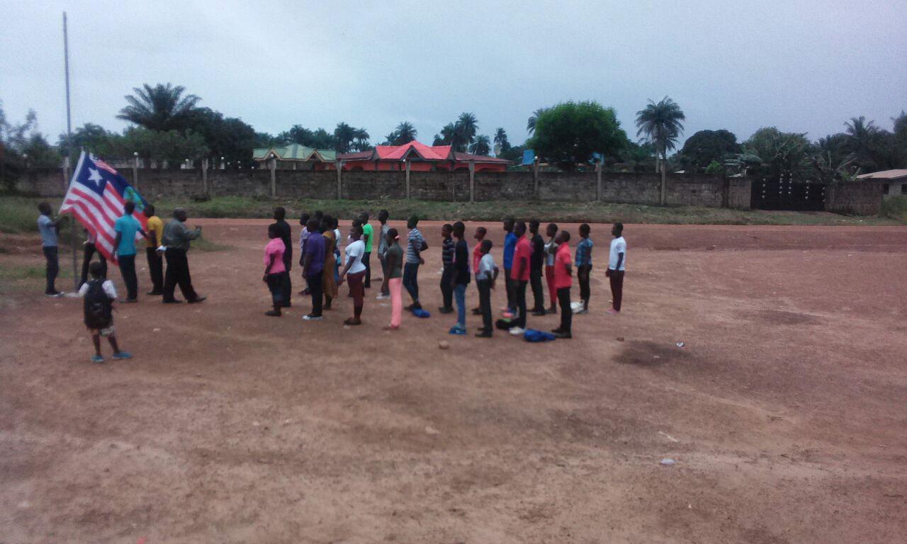 children having flag ceremony